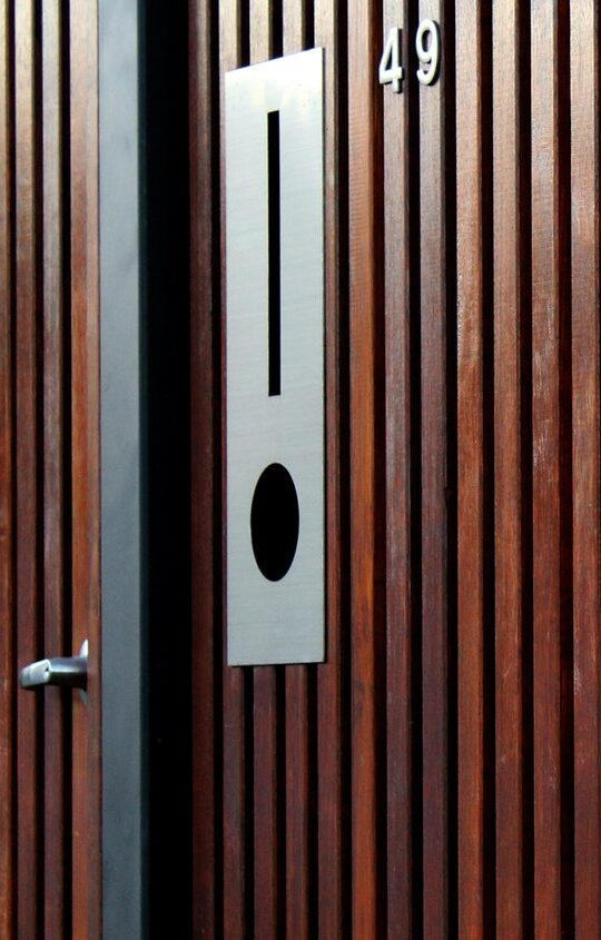 Wooden fence with letterbox